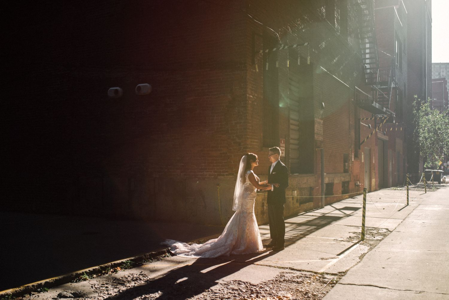 sunlight in alley wedding portrait bride and groom at heinz history center strip district pittsburgh